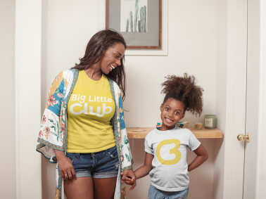 t-shirt-mockup-of-a-happy-girl-at-home-with-her-mom-a21329